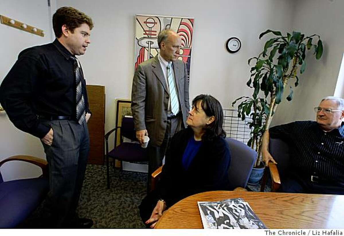Neurologist Gil Rabinovici (left), MD, and director of UCSF Memory and Aging center Bruce Miller (standing, middle), MD, talk with Claudia Benedetti (seated), 61 years old, from Pacifica and her husband Allen Benedetti (seated) at UCSF on Monday, July 7, 2008. Trying to push for more early diagnosis of all forms of dementia Bruce Miller, MD, made the intiial diagnosis of Claudia who has early age of onset Alzheimer�s disease at UCSF in San Francisco, Calif.Photo by Liz Hafalia/The Chronicle