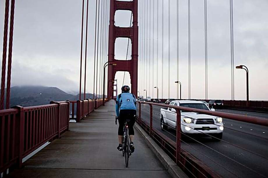 Dr. Bill Bradford, of biopharmaceutical company InterMune, rides across the Golden Gate Bridge during his 32-mile bike commuting trip from his Brisbane office to home across the Golden Gate Bridge in Ross, Calif. on Wednesday, Dec. 2, 2009. Photo: Stephen Lam, Special To The Chronicle