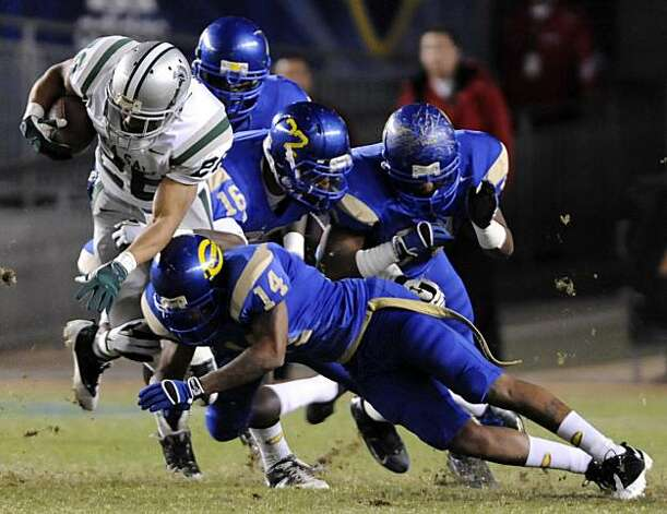 De La Salle's Terron Ward, left, is tackled by Crenshaw's Geno Hall in the first quarter during the 2009 CIF Open Division State Bowl Game between De La Salle High School and Crenshaw High School at the Home Depot Center in Carson, Calif., on Saturday, Dec. 19, 2009. Photo: Carlos Delgado, Special To The Chronicle