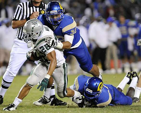 De La Salle's Terron Ward, left, is tackled by Crenshaw's Hayes Pullard in the first quarter during the 2009 CIF Open Division State Bowl Game between De La Salle High School and Crenshaw High School at the Home Depot Center in Carson, Calif., on Saturday, Dec. 19, 2009. Photo: Carlos Delgado, Special To The Chronicle
