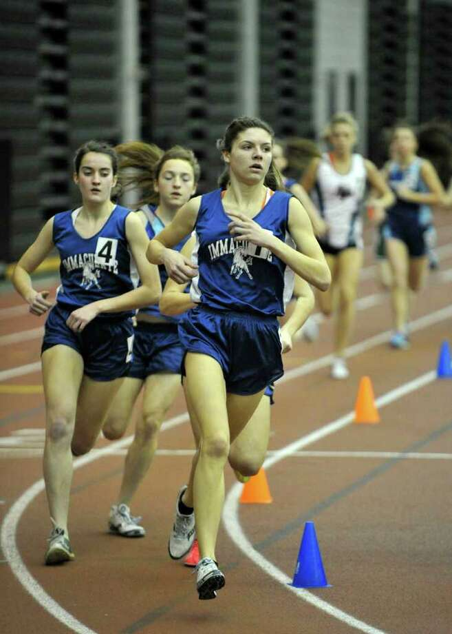 Immaculate's Maggie Christe leads the pack in the 1600-meter-run during the SWC indoor track and field championships at Hillhouse High School in New Haven on Saturday, Feb. 4, 2012. Christe set the SWC championship record for the 1600 meter-run. Photo: Jason Rearick / The News-Times