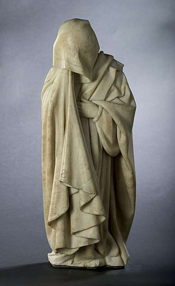 "This undated picture provided by the Dallas Museum of Art shows the sculpture Mourner No. 52 from the Tomb of Jean Sans Peur (John the Fearless), second Duke of Burgundy. The nearly 40 ""mourners"" commissioned in the 15th century to adorn the tomb will be seen together for the first time outside of France when they begin a tour of seven U.S. cities in Spring 2010. (AP Photo/Dallas Museum Of Art) Photo: AP"