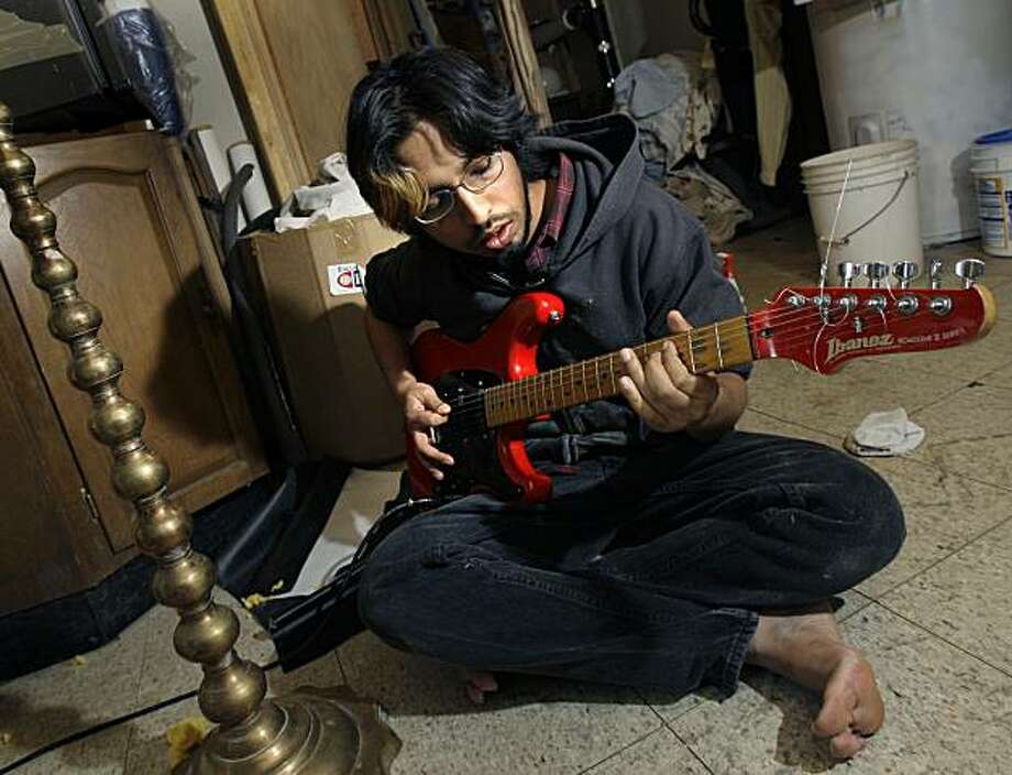 """This Dec. 15, 2009 photo shows Arjun Ray of the Muslim Hindu punk band The Kominas, rehearsing in Wayland, Mass. From the basement of this middle-class home tucked in the woods west of Boston, The Kominas have helped launched a small, but growing, South Asian and Middle Eastern punk rock movement that is attracting children of Muslim and Hindu immigrants and drawing scorn from some traditional Muslims who say their political, hard-edged music is """"haraam,"""" or forbidden. (AP Photo/Elise Amendola) Photo: Elise Amendola, AP"""