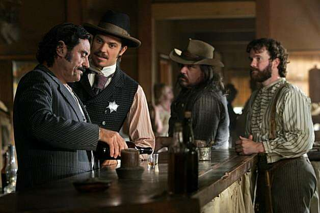 DEADWOOD: Ian McShane, Timothy Olyphant, W. Earl Brown, Sean Bridgers. photo: Doug Hyun Ran on: 06-02-2006 Ian McShane, Timothy Olyphant, W. Earl Brown and Sean Bridgers in HBO's &quo;Deadwood,&quo; which starts Season 3 on June 11. Ran on: 06-18-2006 Ian McShane, Timothy Olyphant, W. Earl Brown and Sean Bridgers in &quo;Deadwood.&quo; Photo: Courtesy, Doug Hyun