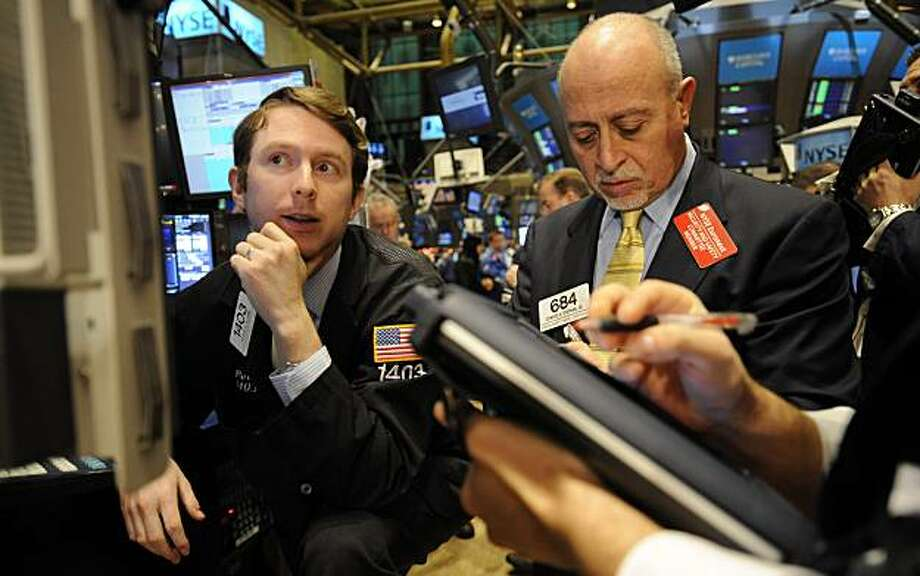 Peter Elkins, left, of LaBranche & Co. and Edward Stephan Jr. of Gordon Haskett Capital Corp. work on the floor the New York Stock Exchange on the final trading day of 2009, Thursday, Dec. 31, 2009, in New York. (AP Photo/Henny Ray Abrams) Photo: Henny Ray Abrams, AP