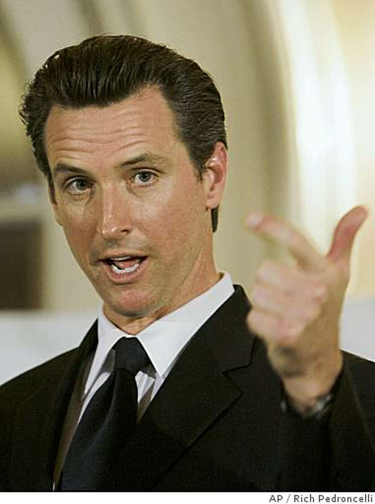 ** FILE ** In this Tuesday, March 25, 2008 file picture, San Francisco Mayor Gavin Newsom addresses the Sacramento Press Club in Sacramento, Calif. Newsom, a Democrat best known for challenging California's ban on same-sex marriage early in his first term, filed papers on Tuesday, July 1, 2008 to form an exploratory committee so he can start raising money and conducting polls for a possible gubernatorial campaign. (AP Photo/Rich Pedroncelli)
