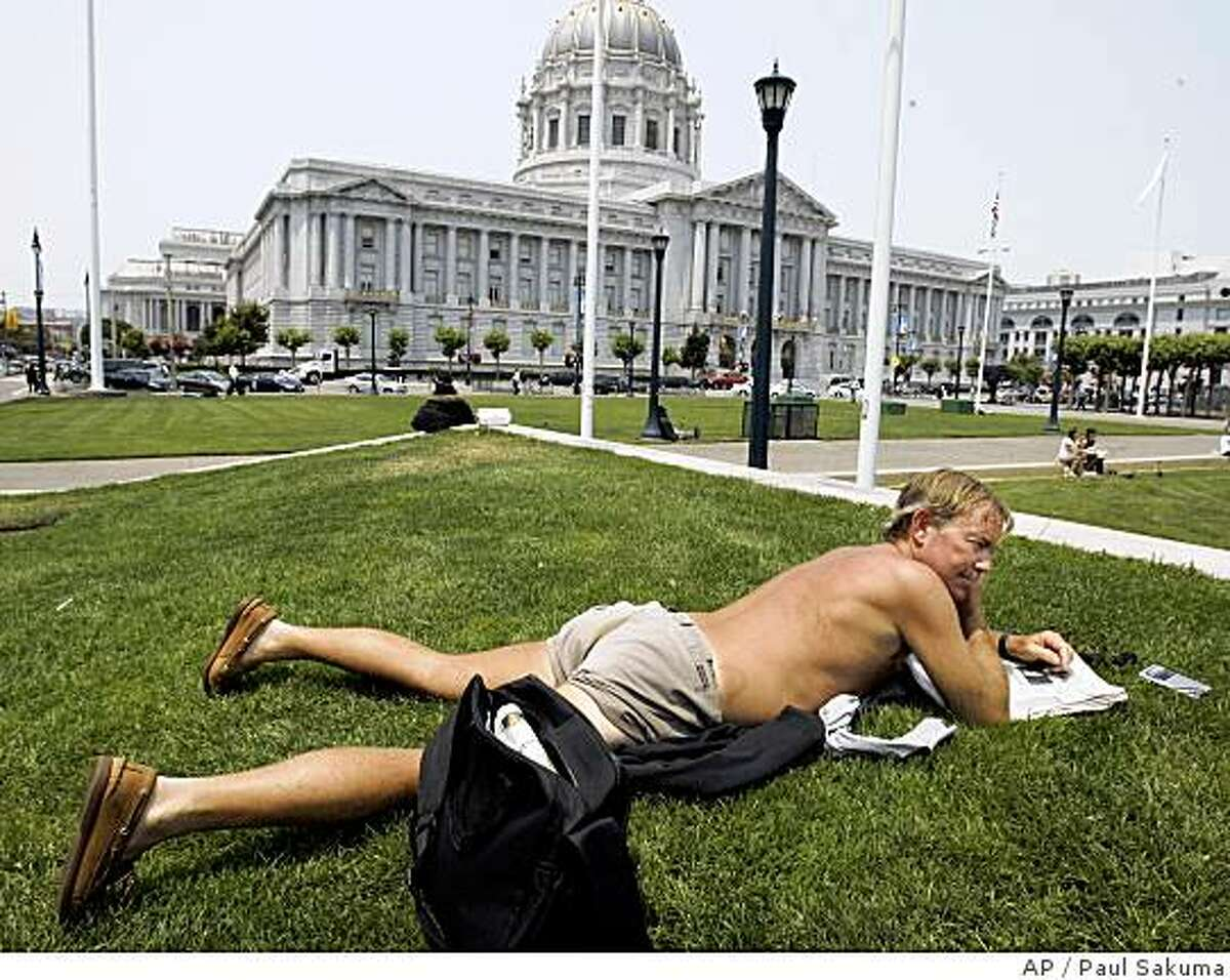 San Francisco resident Kenneth Peterson takes a sun tan in front of San Francisco City Hall during a warm afternoon in San Francisco, Monday, July 7, 2008. (AP Photo/Paul Sakuma)