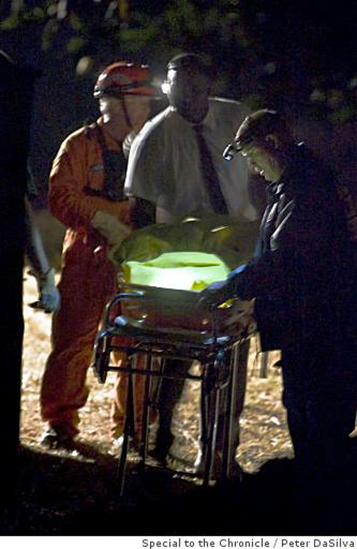 Alameda County Sheriff Coroner's Bureau and other recovery personnel, prepare to load the remains of a body for transportation after authorities recovered them near a hiking trail off Skyline Blvd. in the Oakland Hills on July 08, 2008.Photo By: Peter DaSilvaSpecial to the Chronicle