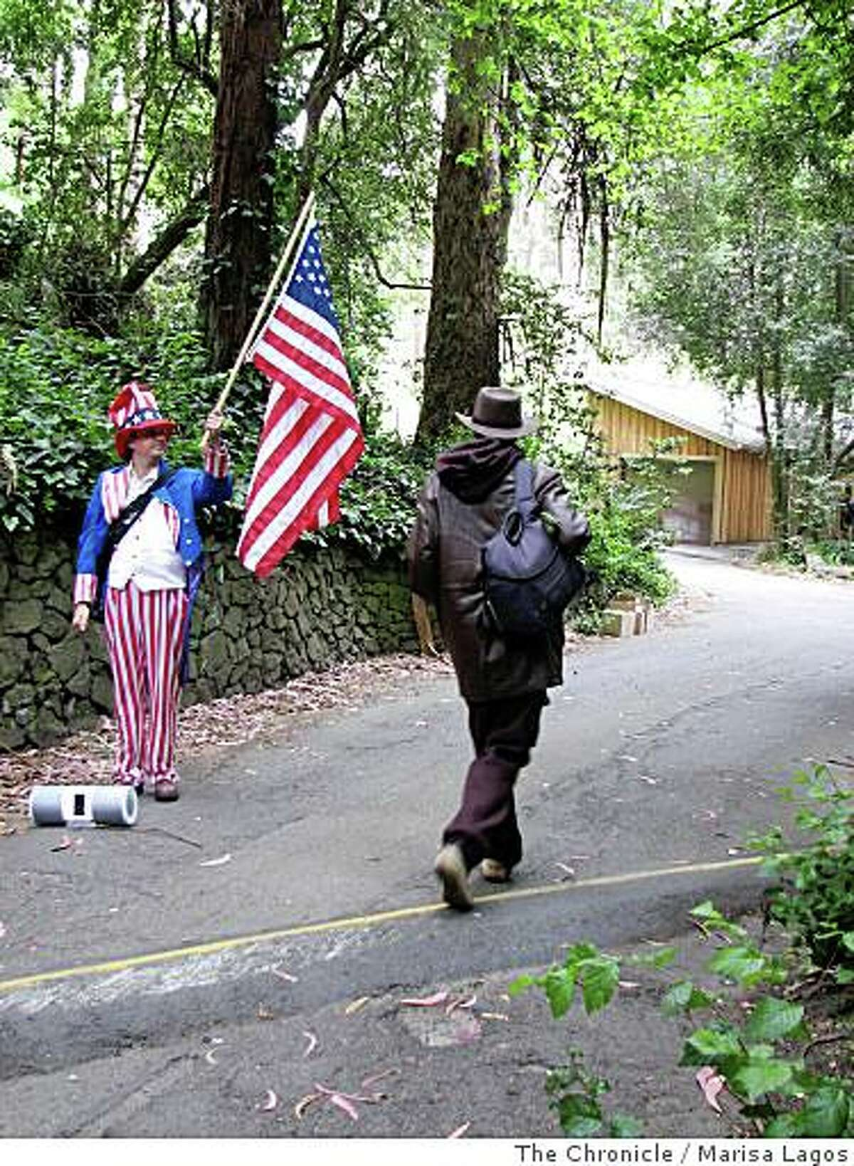 T. Wayne Pickering (Brian McConnell, left) stands at Stern Grove dressed as uncle Sam and blaring patriotic music from his boom box, trying to get more signatures for a ballot petition to rename the Oceanside Water Pollution Control Plant the George W. Bush Treatment Plant on Monday, June, 23, 2008, in San Francisco, Calif.