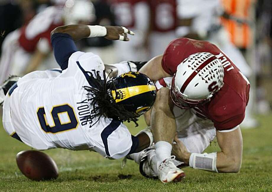 Cal's Eddie Young and Stanford's Andrew Luck scramble for a loose ball in the second quarter of the Big Game on Saturday. Photo: Michael Macor, The Chronicle