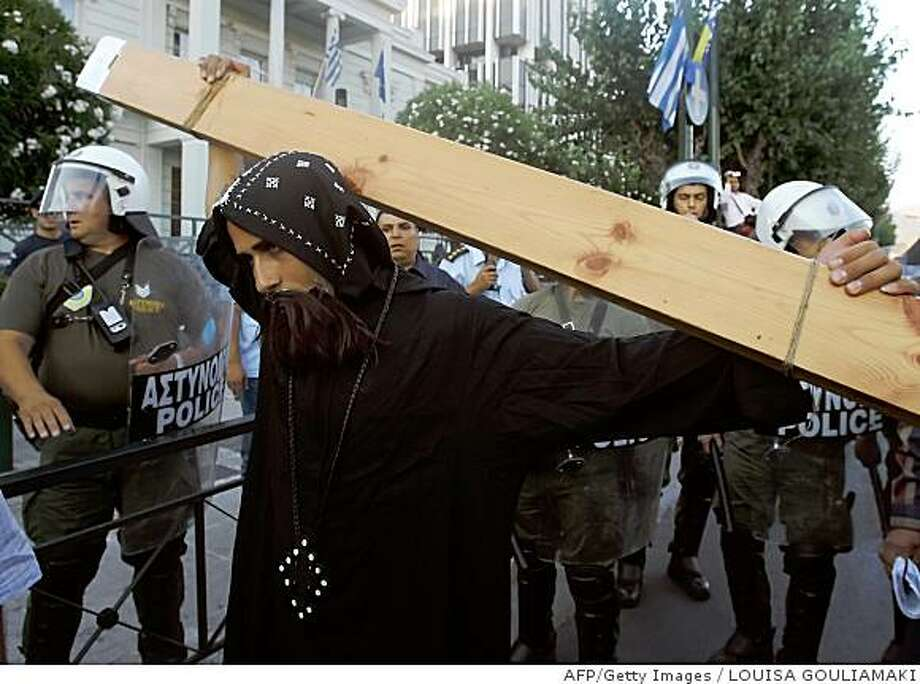Egyptian Coptic Christians stage a protest outside Egypt's embassy in central Athens on June 25, 2008. Some 300 Egyptian Christians demonstrated the repeated attacks by Muslims against their community in Egypt. AFP PHOTO / Louisa Gouliamaki (Photo credit should read LOUISA GOULIAMAKI/AFP/Getty Images) Photo: LOUISA GOULIAMAKI, AFP/Getty Images