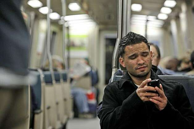 Tim Lopez of Concord, has a little trouble finding his AT&T service while inside the tube. Riders should  be able to talk or connect to the internet while crossing the Bay inside  BART's transbay tube which has been equipped with service by four providers,  in San Francisco, Ca., on Tuesday December 22, 2009. Photo: Michael Macor, The Chronicle