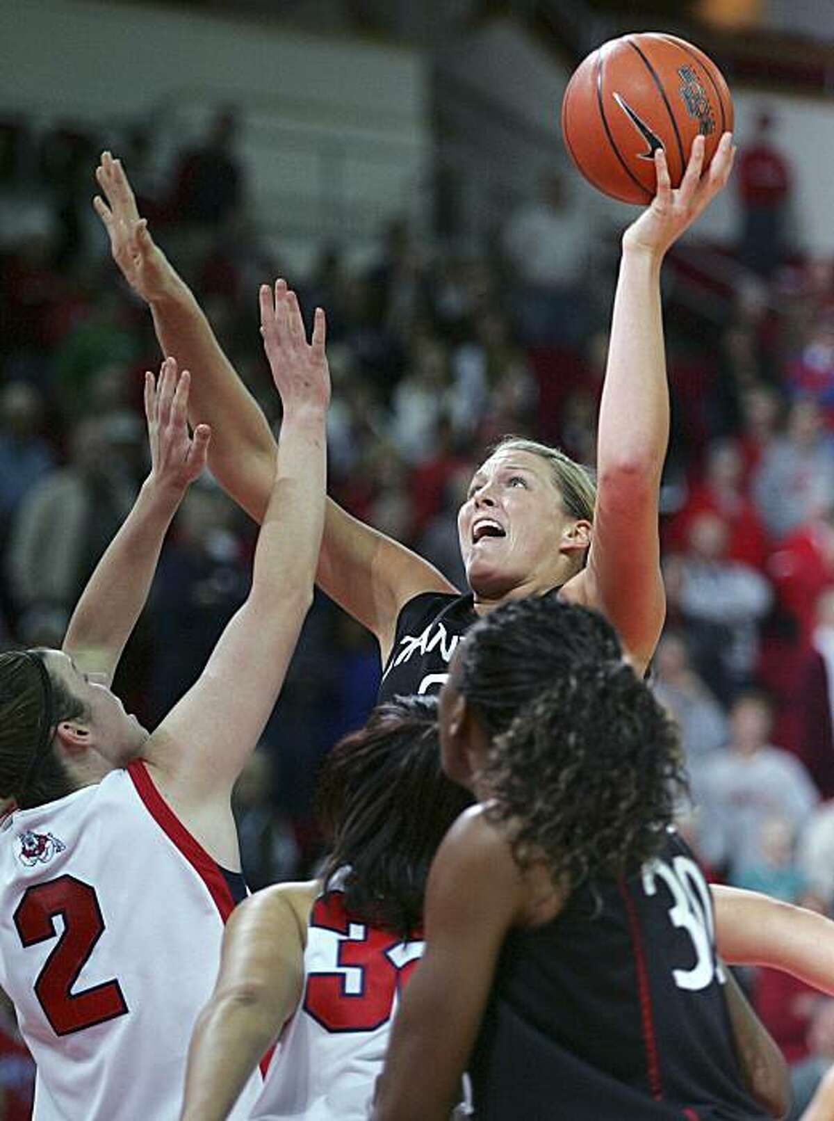 Stanford's Jayne Appel puts up a shot against Fresno State's Hayley Munro during the first half of an NCAA college basketball game Wednesday, Dec. 30, 2009, in Fresno, Calif. (AP Photo/Gary Kazanjian)
