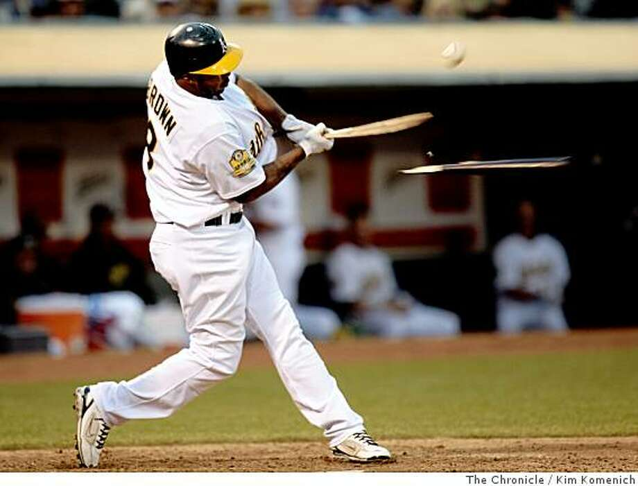Emil Brown breaks his bat as he singles in the eighth inning as the Oakland Athletics play the Anaheim Angels on Saturday. Chronicle photo by Kim Komenich Photo: Kim Komenich, The Chronicle
