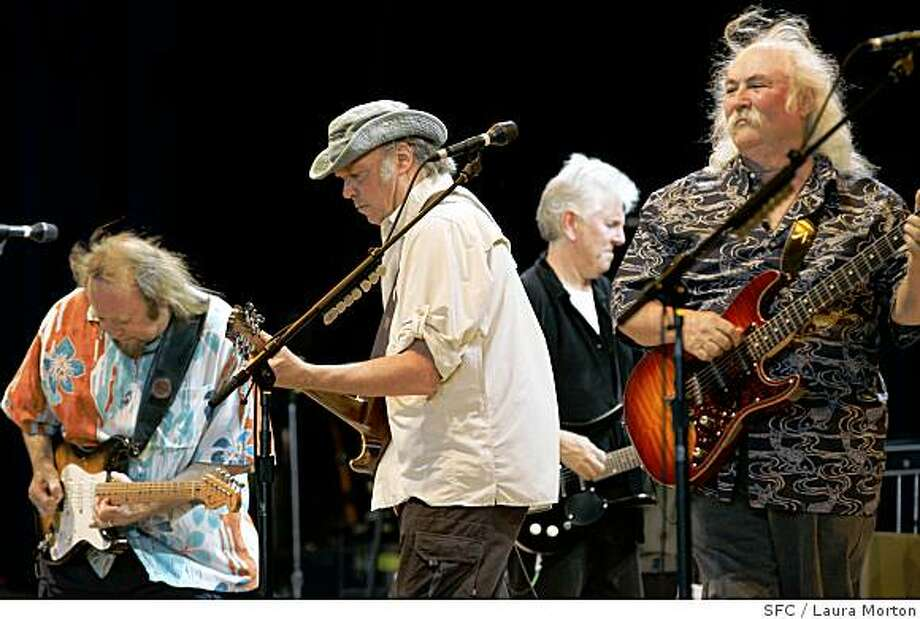 Stephen Stills, Neil Young, Graham Nash and David Crosby (left to right) of Crosby, Stills, Nash and Young perform during a stop on their Freedom of Speech reunion tour at the Sleep Train Pavilion in Concord, CA on Tuesday, July 25, 2006. Photo: Laura Morton, SFC