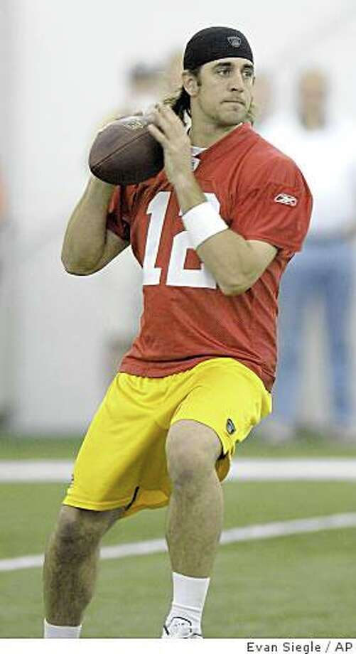 Green Bay Packers quarterback Aaron Rodgers (12) drops back while running a play during voluntary spring NFL football practice inside the Don Hutson Center in Green Bay, Wis., on Wednesday, May 21, 2008. (AP Photo/Green Bay Press-Gazette, Evan Siegle) Photo: Evan Siegle, AP