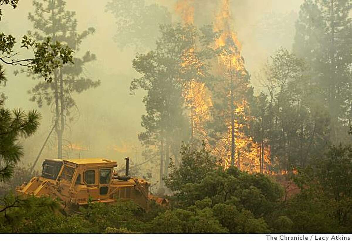 Firefighters use bulldozers to cut a fire line, Friday July 11, 2008 in Paradise,Calif. Photo by Lacy Atkins /The Chronicle