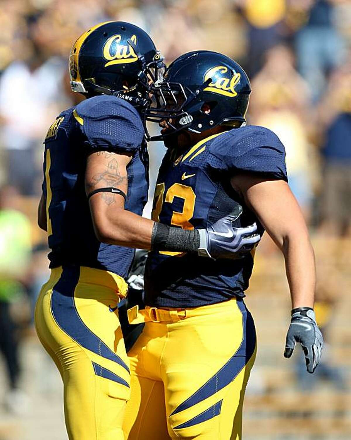 BERKELEY, CA - OCTOBER 24: Marvin Jones #1 of the California Golden Bears celebrates with teammate Brain Holley #33 after scoring a tochdown in the 1st half against the Washington State Cougars at California Memorial Stadium on October 24, 2009 in Berkeley, California. (Photo by Jed Jacobsohn/Getty Images)
