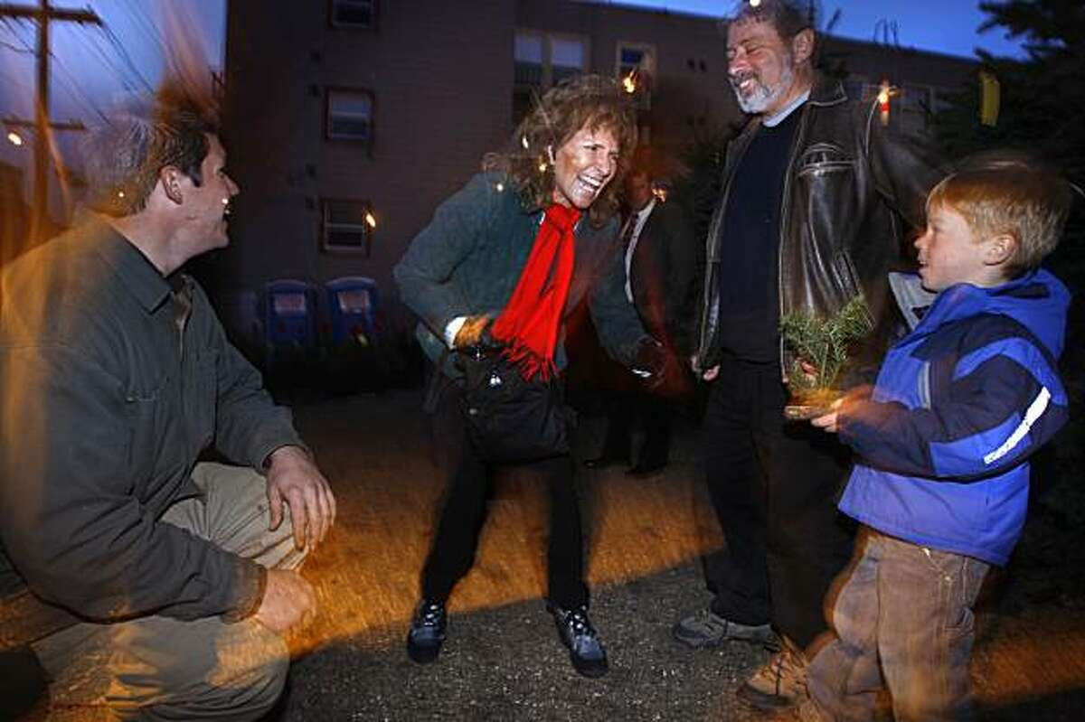 Mimi Silbert, the founder of Delancy Street, dropping in on a Delancy Street Christmas tree lot in San Francisco, Ca., on Wednesday, December 9, 2009. She is talking with Paul Manasian and his son Aidan Manasian, 5 years old.