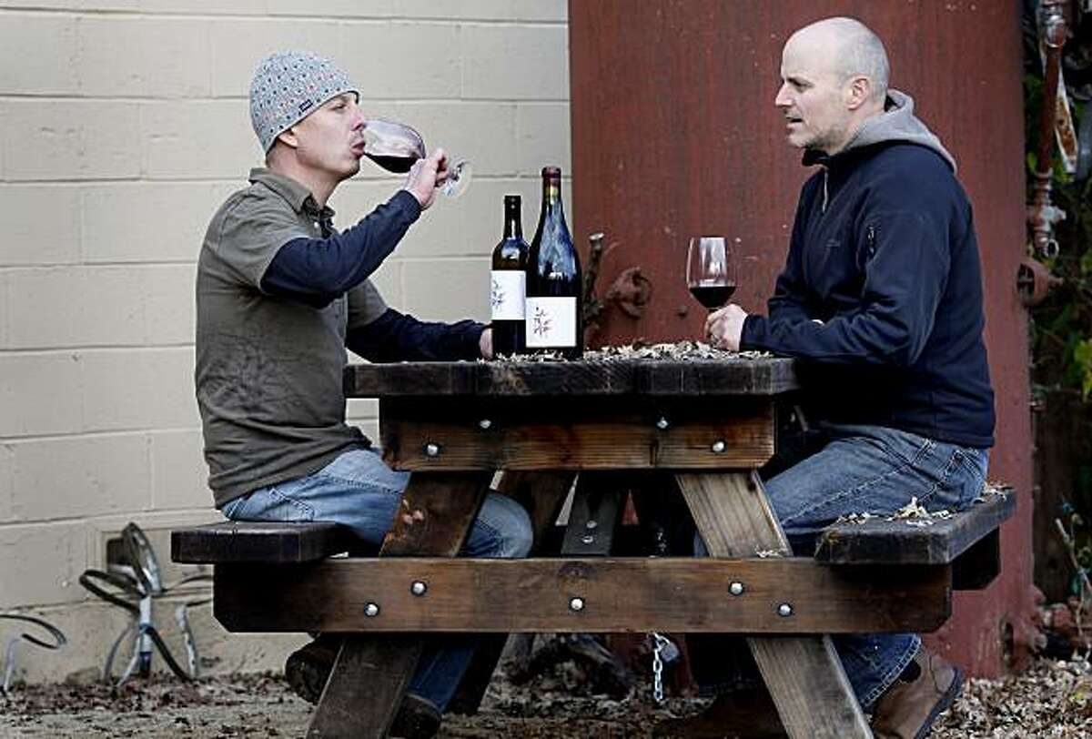 Meyers (left) and Arnot enjoy a tasting just outside their facility. Duncan Arnot Meyers and Nathan Lee Roberts of Arnot-Roberts in Forestville have been friends since childhood.