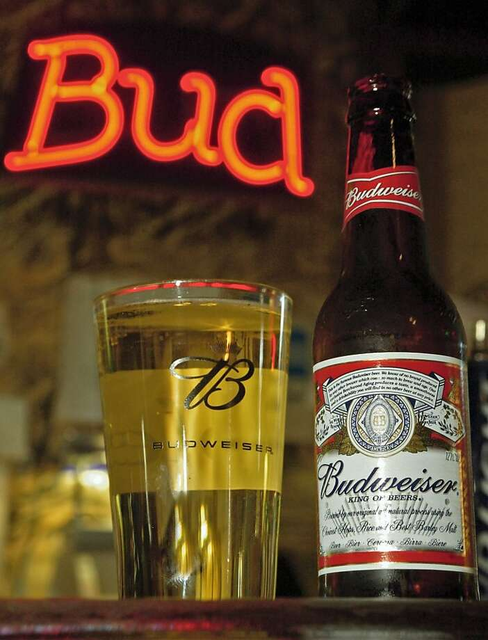 In this Oct. 25, 2005 file photo, bottled and draught Budweiser beers are shown at Foley's Bar in St. Louis.   After weeks of public bickering, Anheuser-Busch Cos. Inc.'s board is likely to accept a sweetened buyout offer from the Belgian-based brewer InBev SA as early as this weekend, a published report said Friday, July 11, 2008. Photo: Tom Gannam, AP