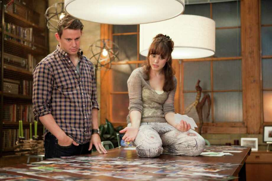 Leo (Channing Tatum) shows Paige (Rachel McAdams) pictures from her past in an attempt to help her remember their life together in The Vow. Photo: Kerry Hayes / © 2010 Vow Productions, LLC.  All rights reserved.
