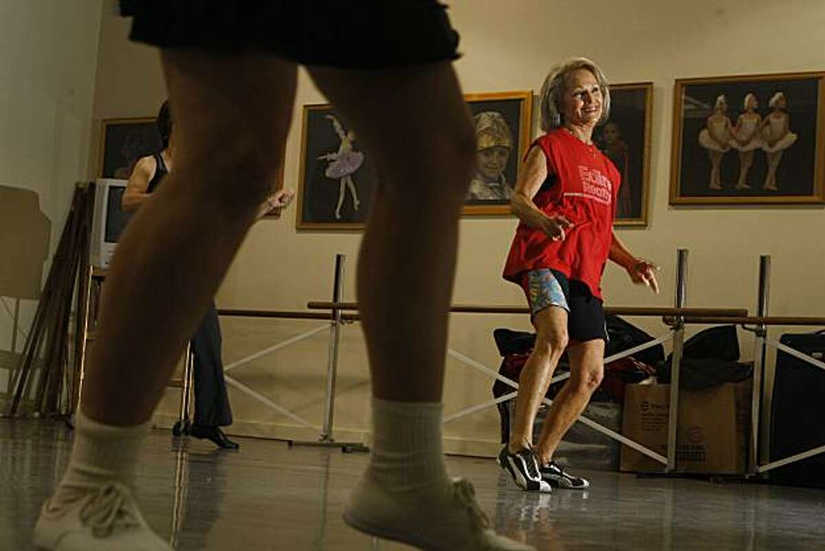 Willow Carter (right) wears her customary Pumas and cut off muscle shirt while working out in her Boomercize class taught by Instructor Marcie Judelson (foreground feet) at the Presidio Dance Theatre in San Francisco, Calif. on Monday December 14, 2009.