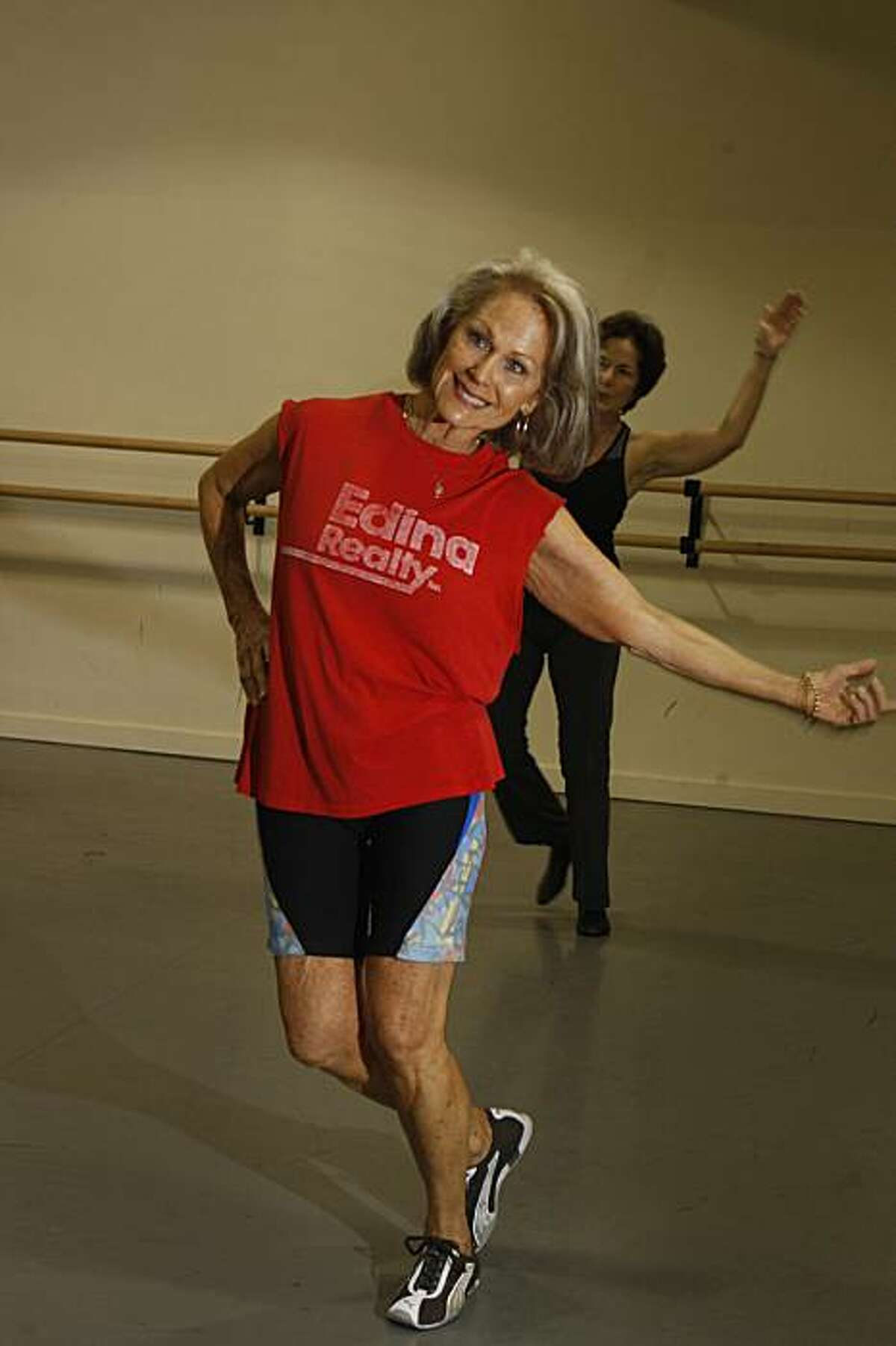 Willow Carter (foreground) wears her customary Pumas and cut off muscle shirt while working out in her Boomercize class at the Presidio Dance Theatre in San Francisco, Calif. on Monday December 14, 2009.