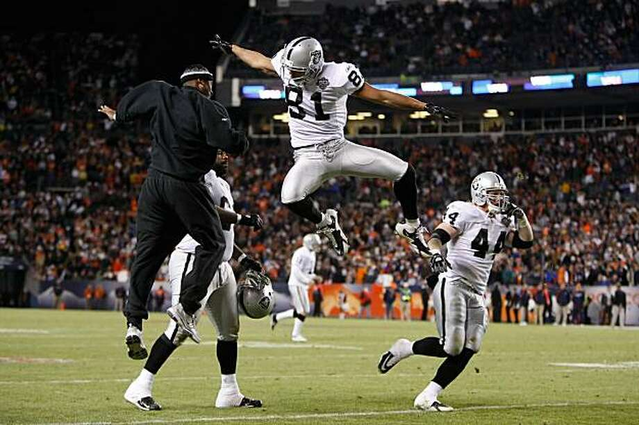 DENVER - DECEMBER 20:  Chaz Schilens #81 of the Oakland Raiders is congratulated by Javon Walker (L) after scoring a touchdown late in the fourth quarter against the Denver Broncos at Invesco Field at Mile High on December 20, 2009 in Denver, Colorado. The Raiders defeated the Broncos 20-19. (Photo by Jeff Gross/Getty Images) Photo: Jeff Gross, Getty Images