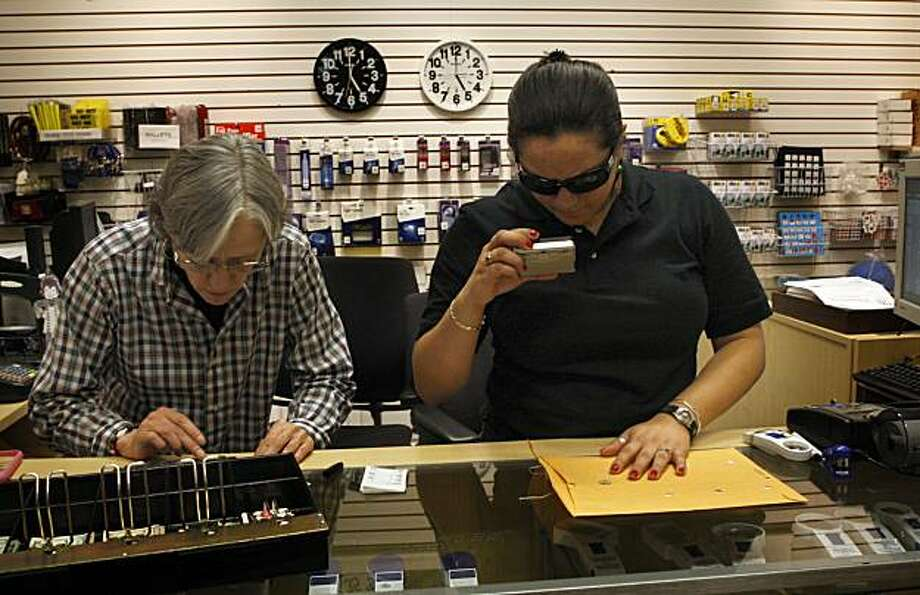 Amber DePietra (left), vision loss resource center specialist, and Lisamaria Martinez (right), adaptations technology sales associate, using a video magnifier as they close shop at The LightHouse Store in San Francisco, Ca., on Monday, December 14, 2009.  The LightHouse for the Blind and Visually Impaired is a local organization that works with persons with limited vision that depend on the internet to be competitive in the market and connect with their communities. Photo: Liz Hafalia, The Chronicle