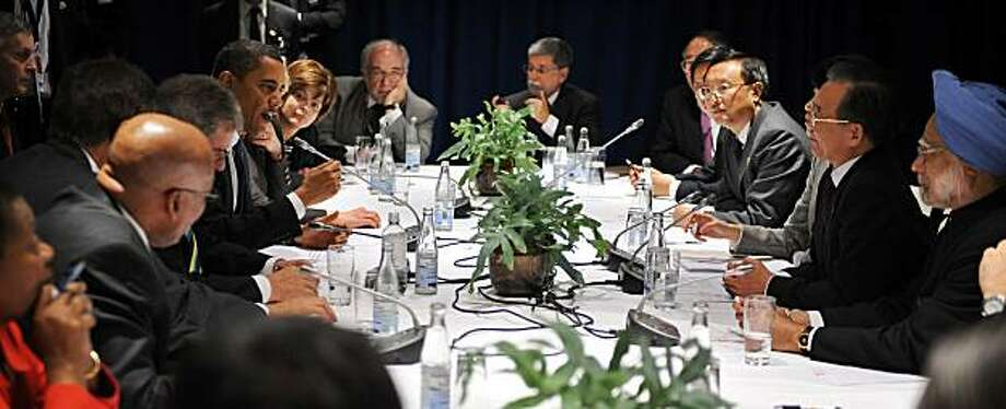 TOPSHOTS US President Barack Obama (C left) speaks during a multi-lateral meeting with Chinese Prime Minister Wen Jiabao (2ndR), Indian Prime Minister Manmohan Singh (R) and other leaders at the Bella Center in Copenhagen on December 18, 2009 on the 12th day of the COP15 UN Climate Change Conference.  TOPSHOTS/AFP PHOTO/ JEWEL SAMAD (Photo credit should read JEWEL SAMAD/AFP/Getty Images) Photo: Jewel Samad, AFP/Getty Images