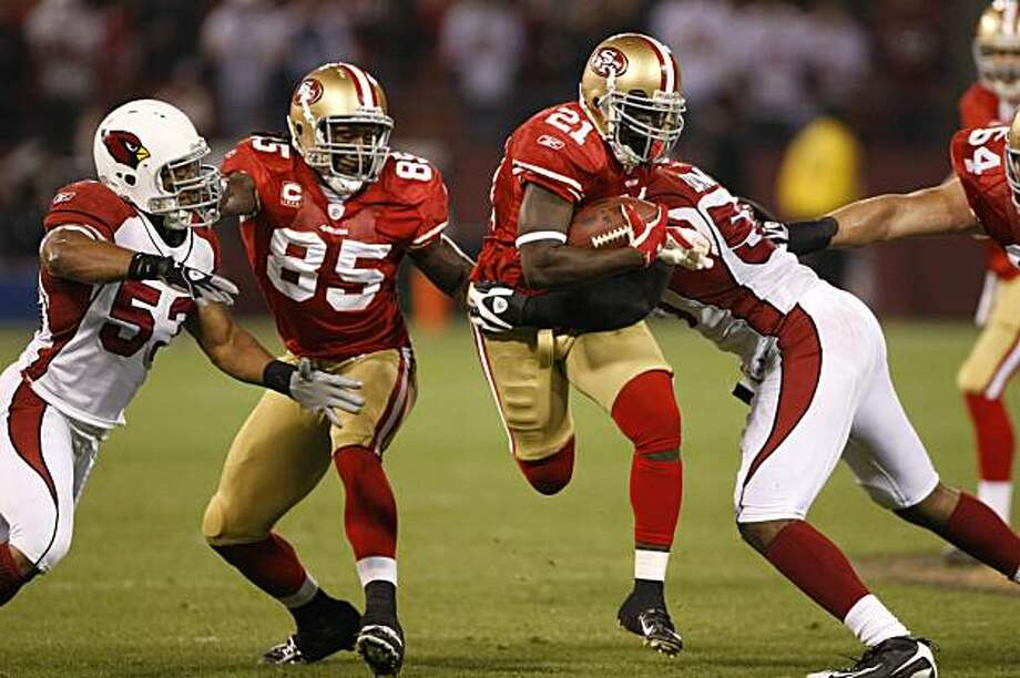 San Francisco 49ers running back Frank Gore (21) tries to run past Arizona Cardinals linebacker Karlos Dansby (58) in the first quarter of an NFL football game in San Francisco, Monday, Dec. 14, 2009. Also pictured is Arizona Cardinals linebacker Clark Haggans (53) and San Francisco 49ers tight end Vernon Davis (85). (AP Photo/Paul Sakuma) Photo: Paul Sakuma, AP