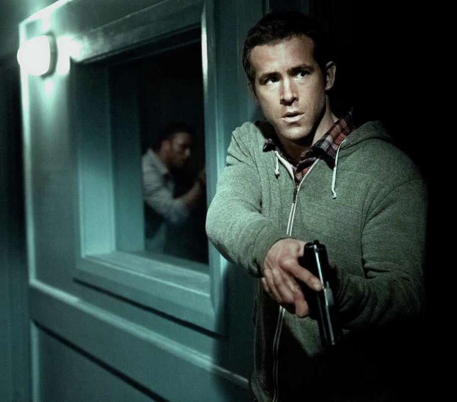Ryan Reynolds plays a CIA agent assigned to protect a dangerous former agent. Photo: Jasin Boland / Copyright: © 2012 Universal Studios. ALL RIGHTS RESERVED.