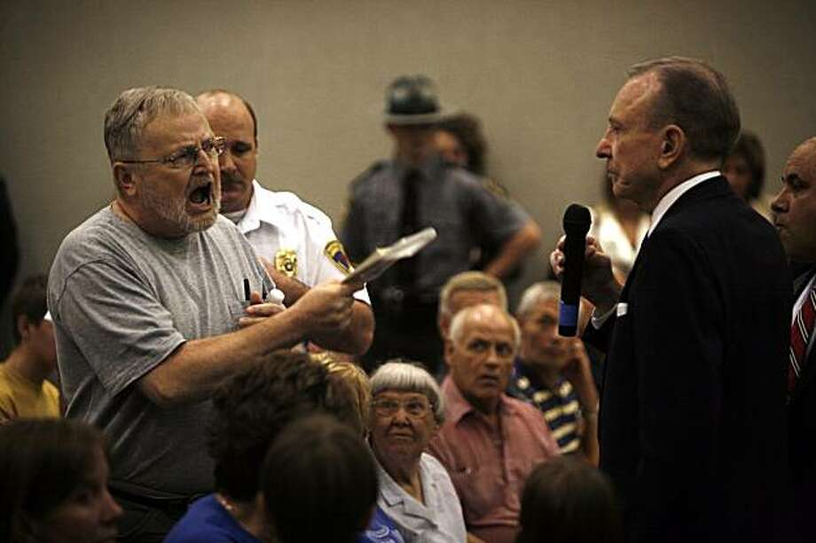 **FILE PHOTO** Sen. Arlen Specter (D-Pa.) faces a hostile audience at a town hall meeting in Lebanon, Pa., on Aug. 12, 2009. (Damon Winter/The New York Times) Photo: Damon Winter, NYT