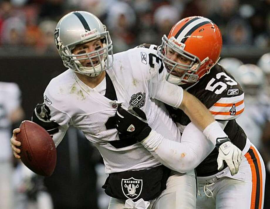 Oakland Raiders quarterback Charlie Frye (3) is sacked by Cleveland Browns defensive end Matt Roth (53) in the fourth quarter of an NFL football game Sunday, Dec. 27, 2009, in Cleveland. The Browns won their third straight, beating the Raiders 23-9. (AP Photo/Tony Dejak) Photo: Tony Dejak, AP