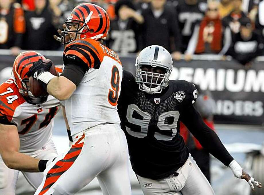 The Raiders' Greg Ellis sacks the Bengals' Carson Palmer in the third quarter in Oakland on Sunday. Photo: Carlos Avila Gonzalez, The Chronicle
