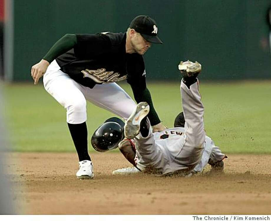A's shortstop Bobby Crosby puts out Fred Lewis on a steal attempt at second base in the sixth inning as the San Francisco Giants beat the Oakland Athletics 1-0 at McAfee Coliseum on Saturday, June 28, 2008. Photo: Kim Komenich, The Chronicle