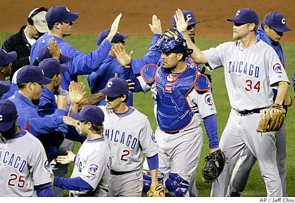 Chicago Cubs' Kerry Wood, right, celebrates after saving the Cubs 6-5 win over the San Francisco Giants in a baseball game in San Francisco, Wednesday, July 2, 2008. (AP Photo/Jeff Chiu)