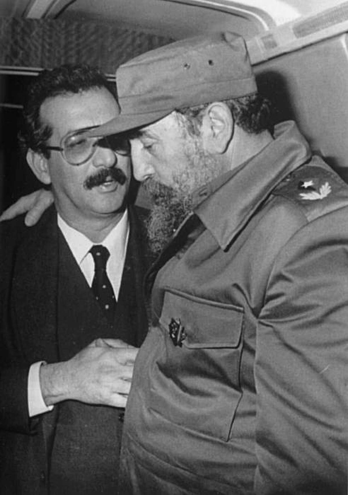 a photo from the collection of author Norberto Fuentes, shown with Fidel Castro.
