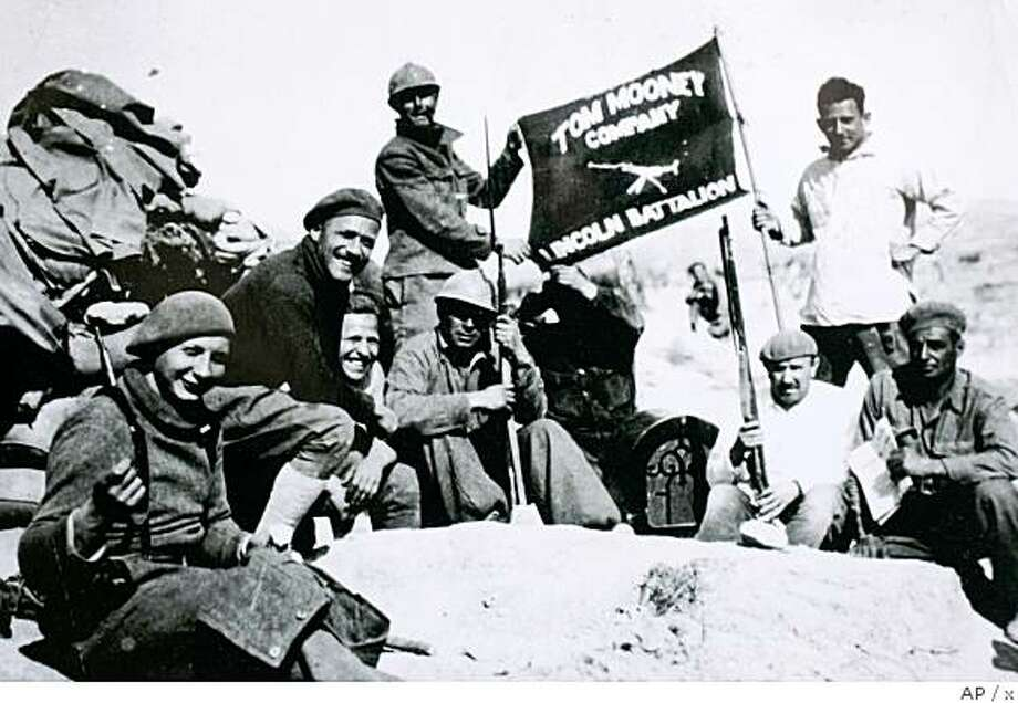 ** APN ADVANCE FOR SUNDAY, APRIL 27 **    In this 1937 photo provided by Spanish Civil War veteran Dave Smith, upper right, shows members of the Lincoln Brigade in Jarama, Spain.  Although the Spanish Civil War has been enshrined in literature and art by the likes of Ernest Hemingway and Pablo Picasso, Americans who risked their lives for the values at stake were never recognized in their home country.   (AP Photo/Courtesy of Dave Smith) Photo: X, AP