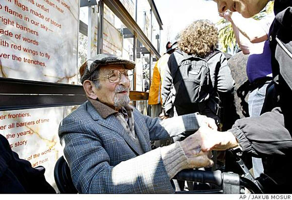 ** APN ADVANCE FOR SUNDAY, APRIL 27 ** Spanish Civil War veteran David Smith, 94, speaks with Joan Balter in front of the Abraham Lincoln Brigade Monument, a memorial to soldiers who fought in the War in San Francisco on Sunday, March 30, 2008. Only about three dozen of those who snuck aboard ships and crossed the mountains from France to fight survived to see the United State's first public memorial to the Abraham Lincoln Brigade, as they were known. (AP Photo/Jakub Mosur)