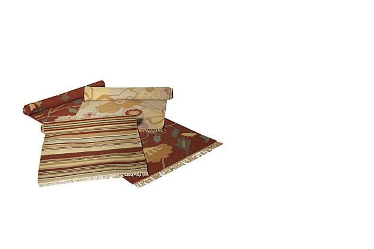 Layer rugs of varying colors, patterns and textures for warmth and richness.