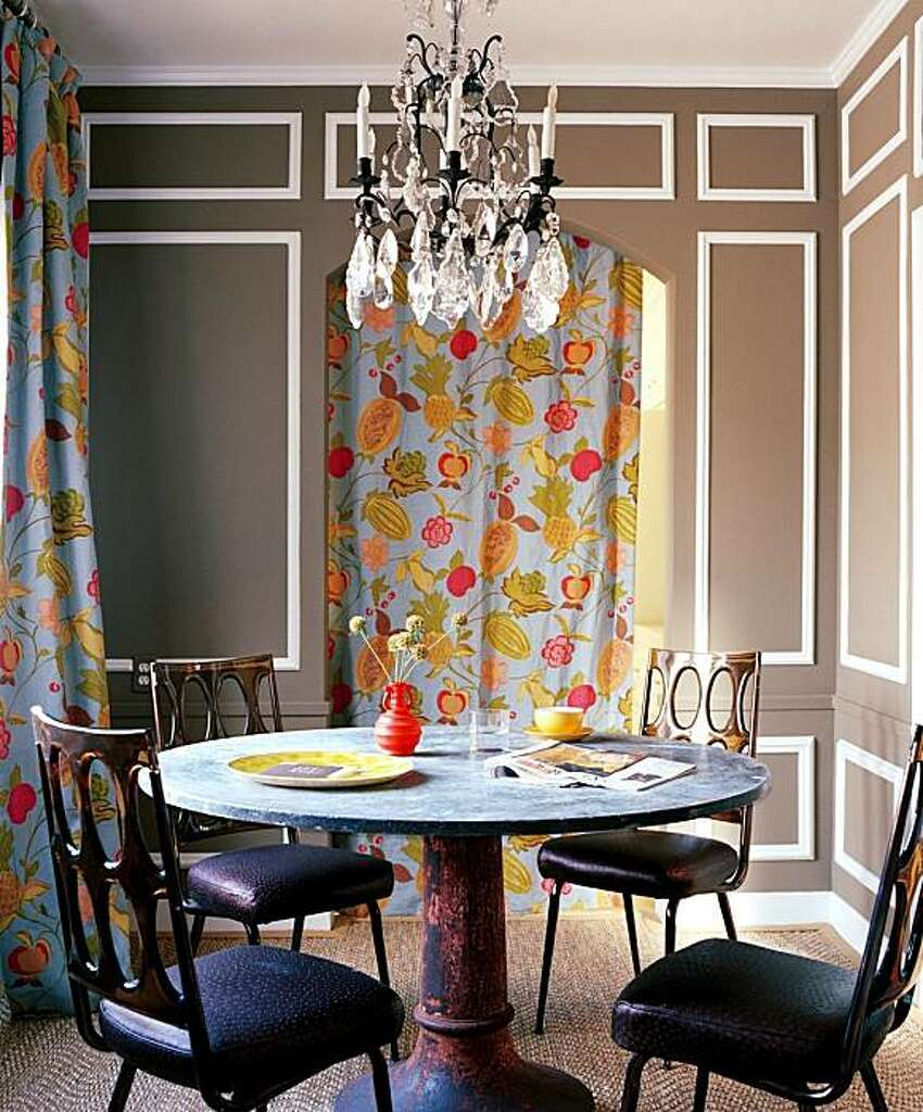 Dining room designed by Kimberly Ayres with vibrant drapery, antique  furnishings, paneling and a