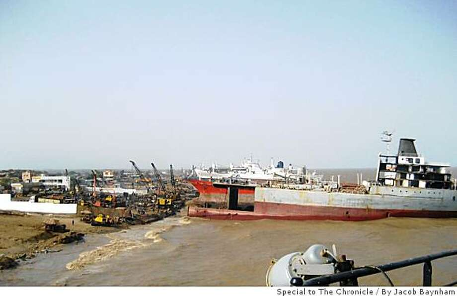 Ships being scrapped on the beach at Alang, India.  Alang recycled 127 ships last year, down from the 428 in peak years in 2001. Photo: By Jacob Baynham, Special To The Chronicle
