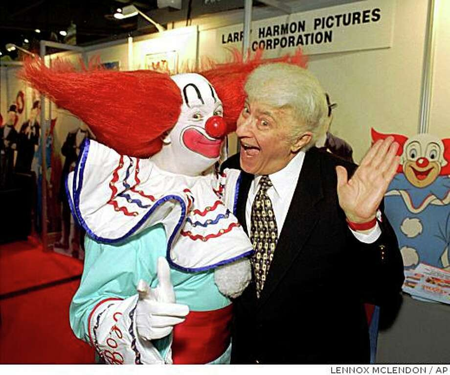 ** FILE ** In this Jan. 24, 1996 file photo, a man dressed as Bozo, left, poses with Bozo creator, Larry Harmon, as they celebrate the character's 50th birthday during the National Association of Television Program Executives convention in Las Vegas. Harmon, who appeared as Bozo the Clown for decades and licensed the name to other Bozos around the world, died Thursday, July 3, 2008, at his home of congestive heart failure,according to his longtime publicist, Jerry Digney. He was 83.   (AP Photo/Lennox McLendon, file) Photo: LENNOX MCLENDON, AP