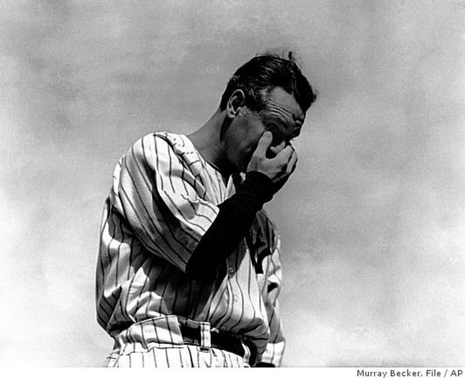 "** ADVANCE FOR WEEKEND EDITIONS, JULY 5-6 -- FILE -- ** In this July 4, 1939 file photo, New York Yankees' Lou Gehrig, the ""Iron Horse"", wipes away a tear during a sold-out tribute at Yankee Stadium in New York.  From Ruth and Gehrig to DiMaggio and Mantle, to Jackson and Jeter, Yankee history is crowded with dynamic players flourishing in a ballpark whose roots date back to a bitter rivalry that was spiced with spite.  (AP Photo/Murray Becker, File) Photo: Murray Becker, File, AP"