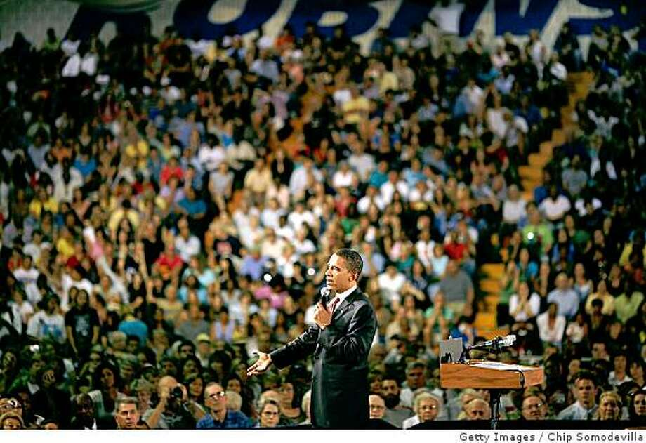 "FAIRFAX, VA - JULY 10:  Presumptive Democratic presidential candidate Sen. Barack Obama (D-IL) speaks at a town hall meeting in the gymnasium at Robinson Secondary School July 10, 2008 in Fairfax County, Virginia. Obama addressed ""economic security for America's Women"" during the rally.  (Photo by Chip Somodevilla/Getty Images) Photo: Getty Images"