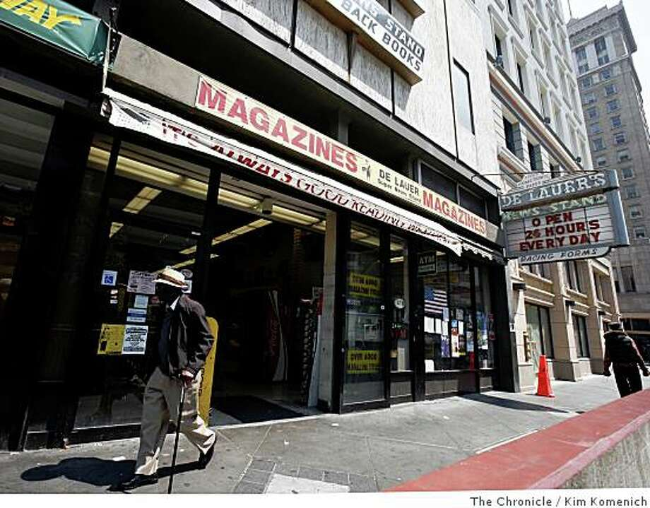A pedestrian walks past DeLauer's Super Newsstand in Oakland, Calif., on Tuesday, June 24, 2008. Opened in 1907, DeLauer's, a downtown Oakland landmark that once was packed with newspapers, magazines and books from across America and beyond, is closing this week, a victim of the slow economy and Internet news sites.Photo by Kim Komenich / The Chronicle Photo: Kim Komenich, The Chronicle