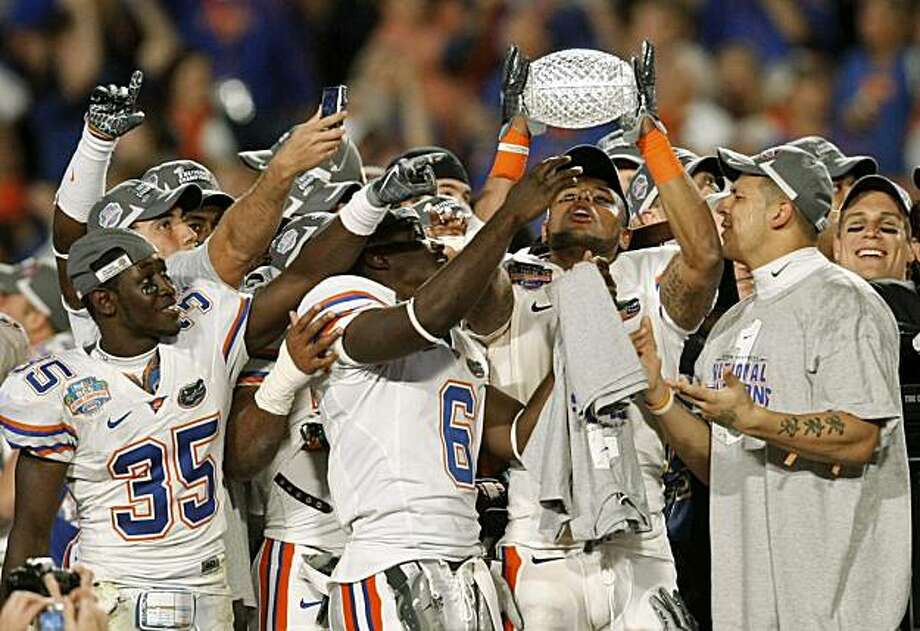 Florida players celebrate with the championship trophy after winning the BCS Championship NCAA college football game against Oklahoma 24-14 in Miami, Thursday, Jan. 8, 2009. (AP Photo/J. Pat Carter) Photo: J. Pat Carter, AP