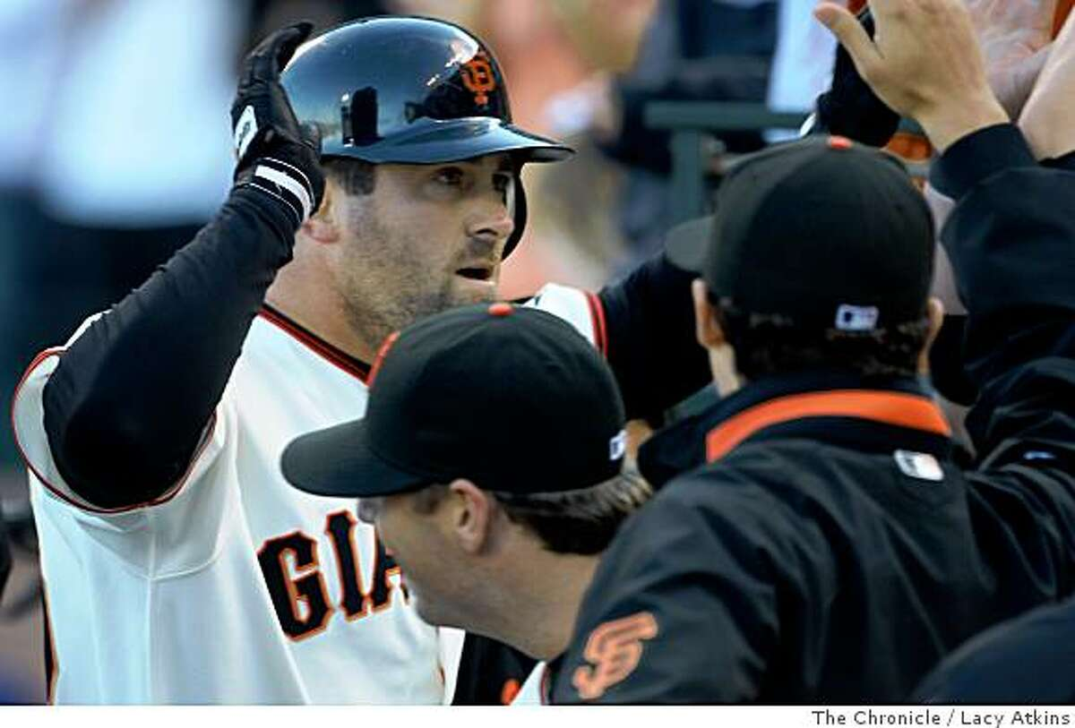 Giants Rich Aurilia is congratulated by his team in the dugout after hitting a two man homerun against the Chicago Cubs, in the seventh inning, Thursday July 3, 2008, in San Francisco, Calif.Photo by Lacy Atkins /The Chronicle